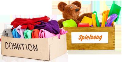 Foto: Kiste mit Kleidung und Kiste mit Spielzeug